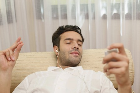 Man listening to music on portable mp3 player photo