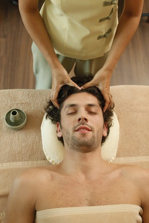 Massage therapist massaging man's head Stock Photo - 7361724