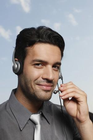 southeastern european descent: Businessman with headset