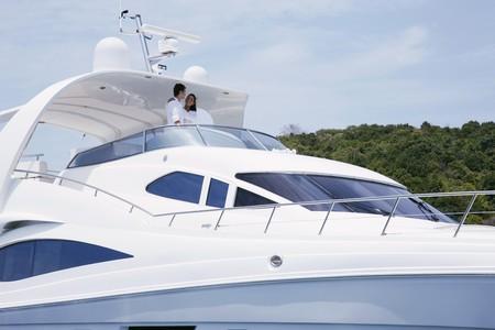 Couple embracing on yacht photo