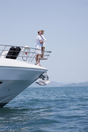 Couple standing at the tip of yacht photo