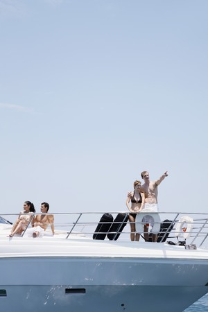 Couples relaxing on yacht Stock Photo - 7361812