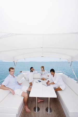 Couples relaxing on yacht Stock Photo - 7361955