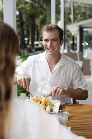 Man and woman having lunch at restaurant Stock Photo - 7361899