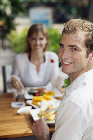 Man and woman having lunch at restaurant photo