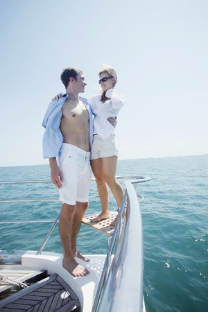 Couple relaxing at the tip of the yacht photo