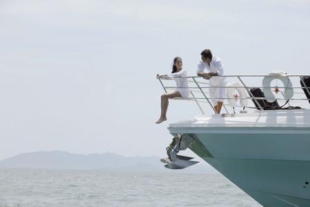 luxury yacht: Couple relaxing on yacht Stock Photo