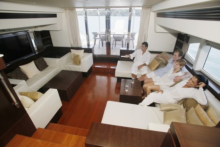 Couples relaxing in yacht living room Stock Photo - 7362553