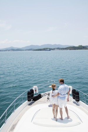 Couple standing on yacht deck photo