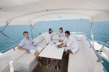 Couples relaxing on yacht Stock Photo - 7362475