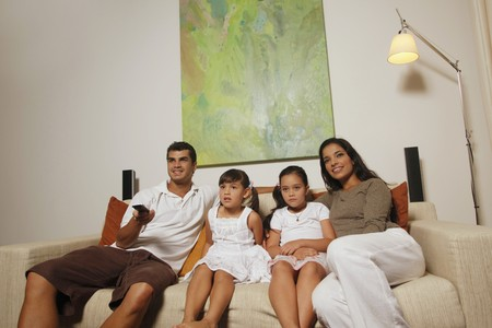 Family watching tv together Stock Photo - 7362269