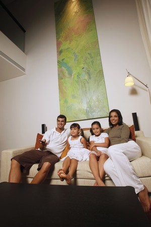 Family watching tv together Stock Photo - 7362132