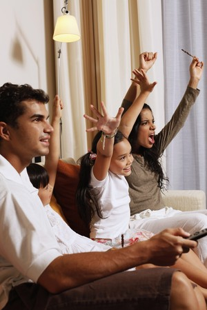 Family watching tv together Stock Photo - 7362010