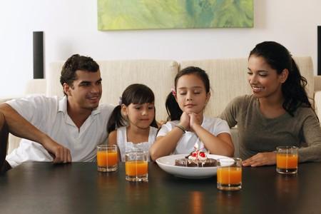 Family celebrating girls birthday photo