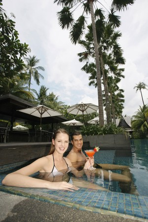 Man and woman sitting in the pool Stock Photo - 7362830
