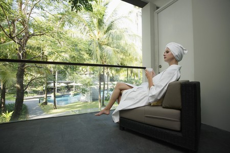 tea towel: Woman in bathrobe enjoying a cup of tea on the balcony