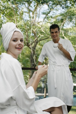 Man and woman drinking tea at the balcony Stock Photo - 7362174
