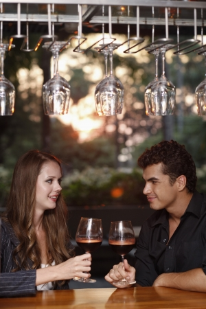 eastern european ethnicity: Man and woman drinking wine at the bar Stock Photo