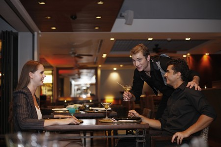 australian ethnicity: Men and woman chatting in a restaurant Stock Photo