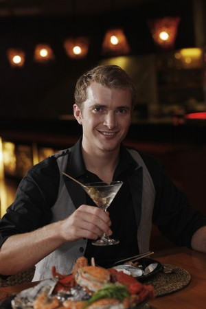 Man with a glass of martini Stock Photo - 7362013