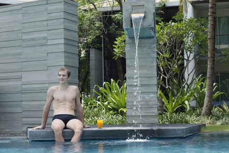 australian ethnicity: Man relaxing by the pool side