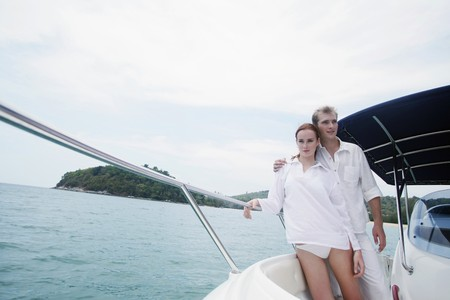 Man and woman on speedboat photo