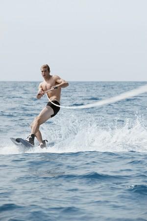 Man waterskiing photo