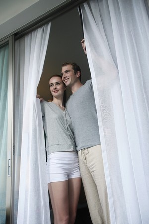 australian ethnicity: Man and woman enjoying the view from room