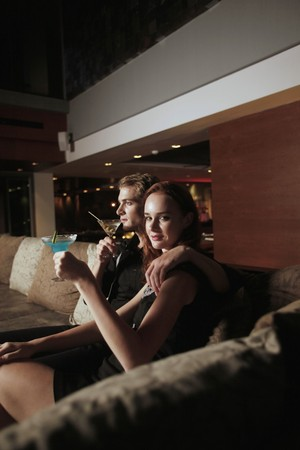 Man and woman with their drinks photo
