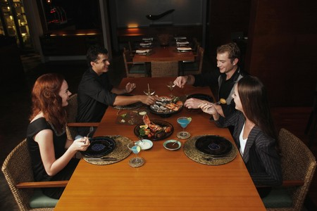 australian ethnicity: Men and women having dinner together