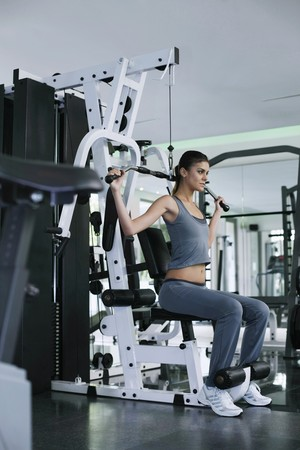 Woman exercising in the gymnasium Stock Photo - 7446508