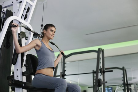 gymnasium: Woman exercising in the gymnasium