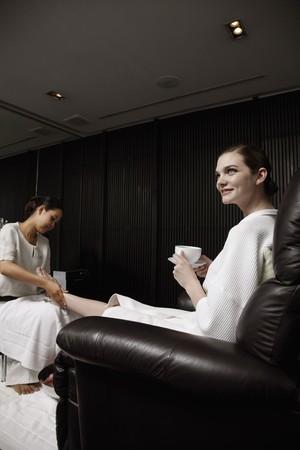 Spa attendant massaging a woman's foot Stock Photo - 7446266