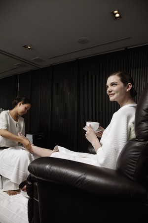 Spa attendant massaging a woman's foot Stock Photo - 7446266