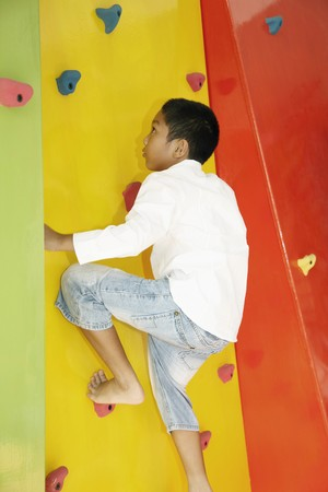 Boy climbing rock wall Stock Photo - 7446157