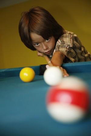 Boy playing pool photo