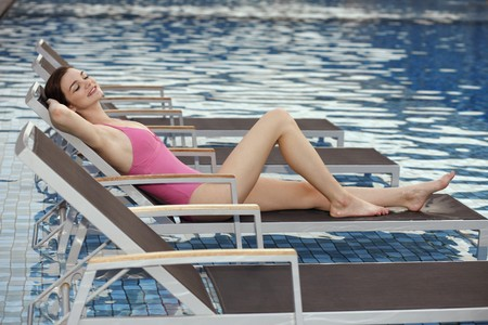 enjoyment: Woman relaxing on lounge chair