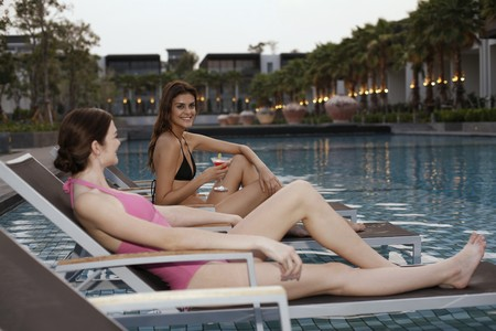 Women relaxing on lounge chairs Stock Photo - 7446454