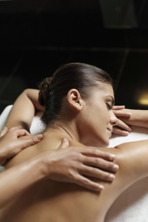 woman spa: Woman receiving a back massage Stock Photo