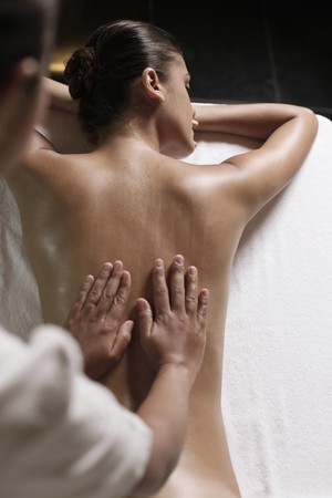 Woman receiving a back massage photo