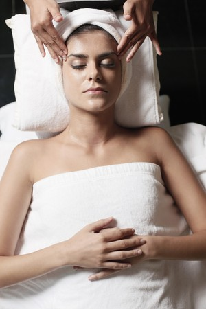 Woman in health spa, having her face washed Stock Photo - 7446497