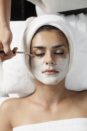 Woman having facial mask applied with brush Stock Photo - 7446107