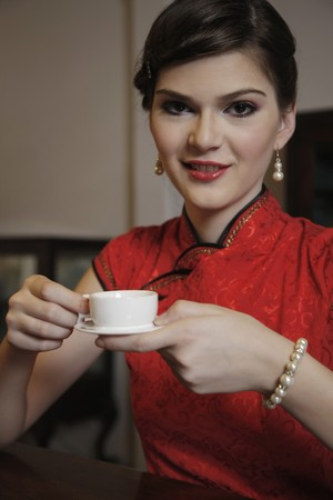 southeastern european descent: Woman with a cup of tea Stock Photo