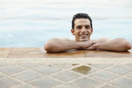 Man in pool smiling photo