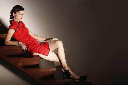 cheongsam: Woman in cheongsam posing on the stairs
