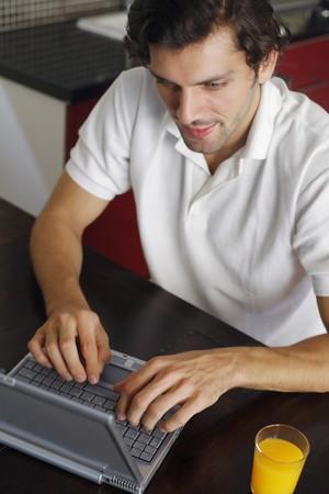 Man using laptop Stock Photo - 7446188