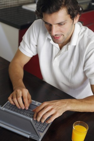Man using laptop Stock Photo - 7446188