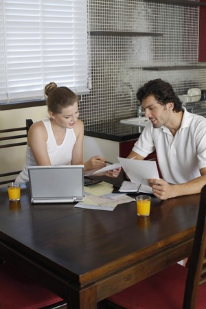 Man and woman sorting out bills together photo