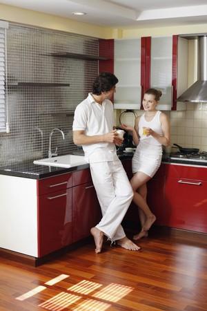 turkish ethnicity: Couple enjoying beverages in the kitchen