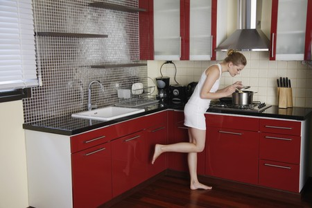 Woman preparing food in the kitchen photo